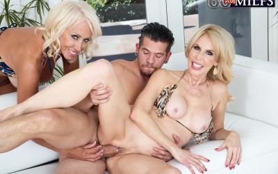 Две зрелые блондинки развлекаются с молодым самцом 14 фото